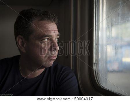 Sad man riding on a train. Real people series.