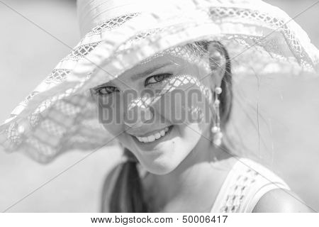 black and white photo of smiling girl