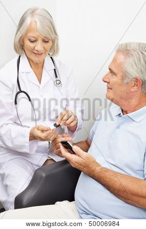 Senior man with diabetes getting blood sugar measurement from doctor