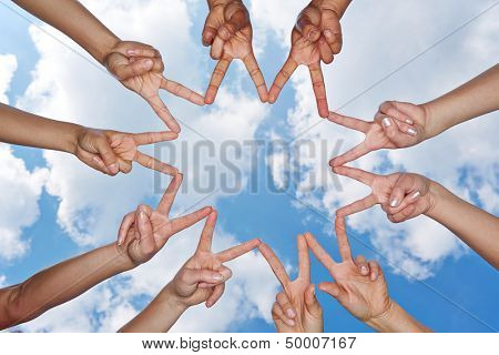 Hands showing star under the sky forming a social network