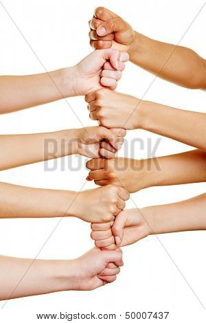 many people building a tower with their hands as teamwork concept