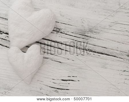 textile hearts on the white wooden background