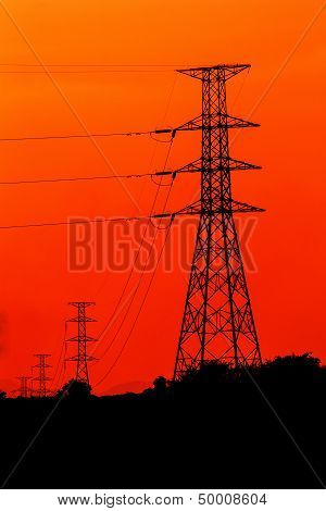 Silhouette Electric Pole On Orange Background