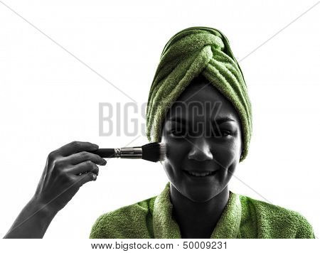 one  woman and make up brush in silhouette  on white background