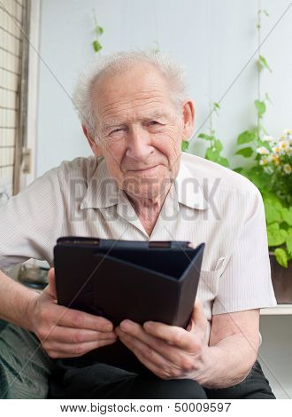Senior Man With A Touchpad Pc