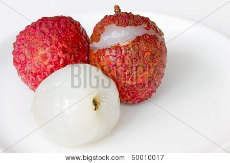 Fresh lechee on the white dish with white background