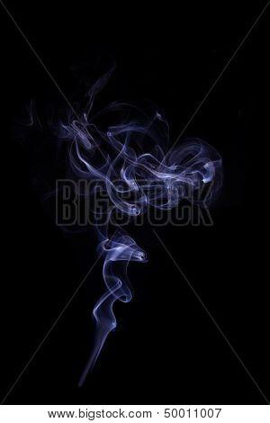 Purple Smoke Isolated On Black.
