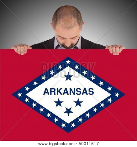 Smiling Businessman Holding A Big Card, Flag Of Arkansas