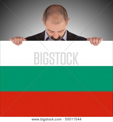 Smiling Businessman Holding A Big Card, Flag Of Bulgaria