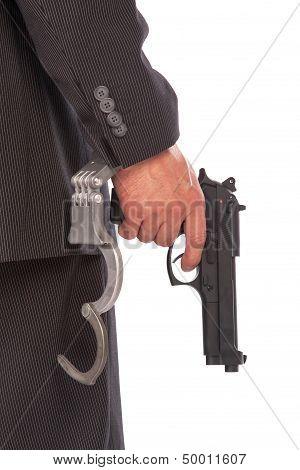 Businessman With Gun And Handcuffs