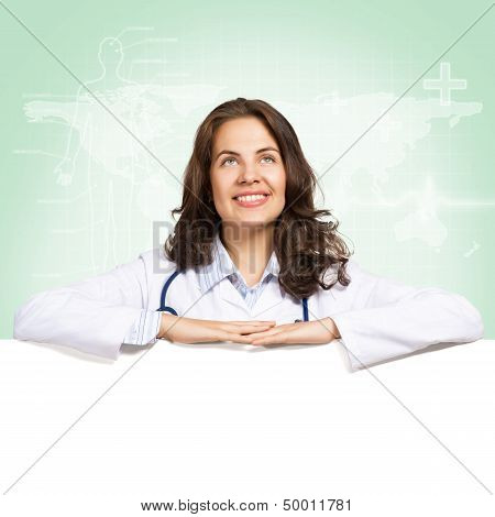 young woman doctor with a blank banner