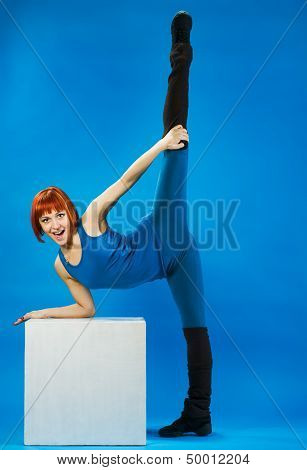 Young red woman stretching