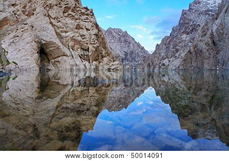 Surprising rocks are reflected in high-mountainous  lake and excellent colour of the sky