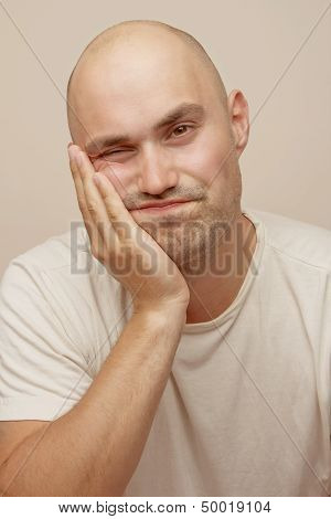 Bald man with toothache