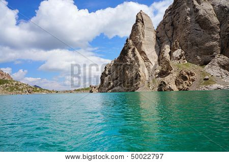 Fine rocks are reflected in high-mountainous  lake and amazing colour of the sky