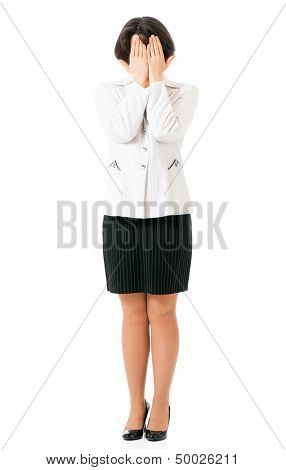 Business woman covering her face with her hands, isolated on white background