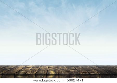 Empty table against blue sky as background for product placement poster