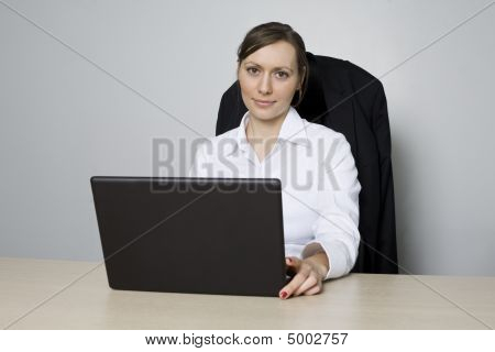 Good looking businesswoman in office