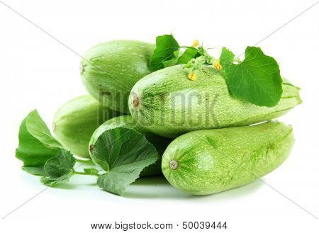Raw zucchini with leaves, isolated on white