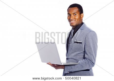 Smiling business man with a laptop computer isolated over a white background