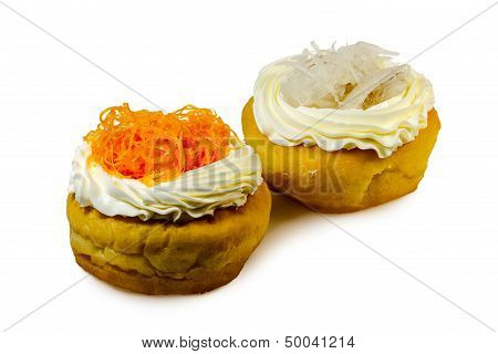 Donuts garnished with white cream and angel hair