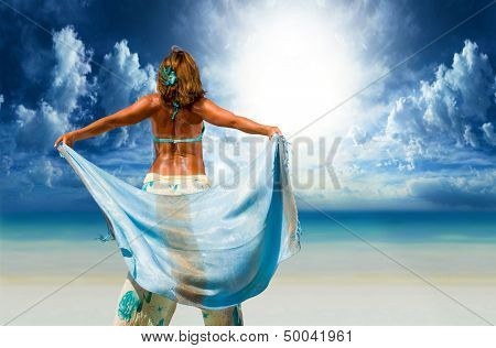 Woman with sarong pareo on the beach