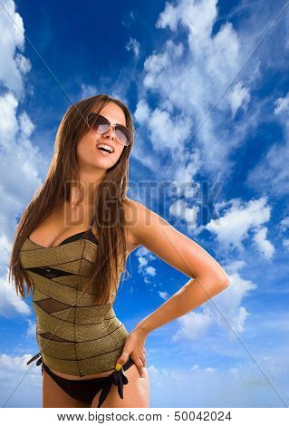 Lady wearing swimsuit in the summertime