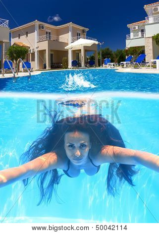 Woman diving underwater in the swimming pool