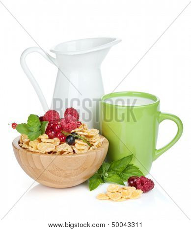 Fresh corn flakes with berries, milk jug and cup. Isolated on white background