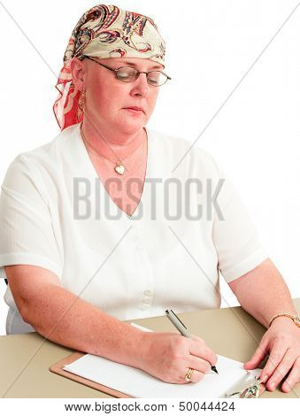 Woman undergoing chemotherapy for cancer is back at work.  White background.