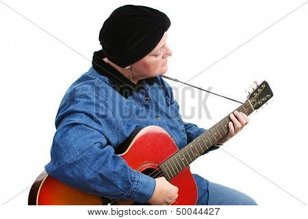 Cancer survivor playing music on her guitar.  Isolated on white.