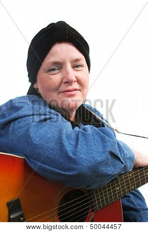 Brave cancer survivor posing for a portrait with her guitar.  White background.