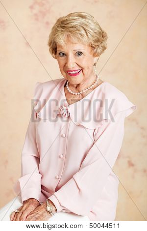 Portrait of a beautiful blond senior woman in her eighties.