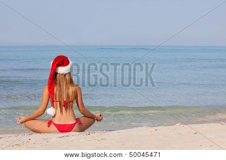 relaxing woman at beach christmas vacation