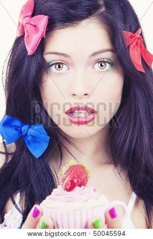 pinup birthday woman with cupcake