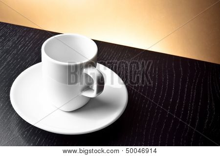 Empty Cup On The Wooden Table
