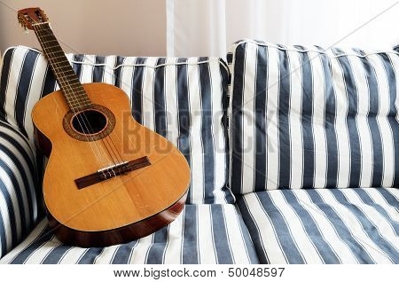 Acoustic Guitar On A Couch