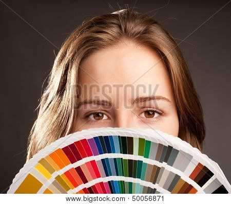 young woman holding a pantone palette