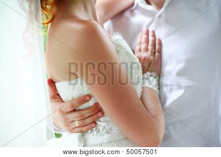 Bride And Groom On Their Wedding Day Hugging