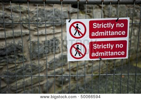 Strictly No Admittance sign on fence