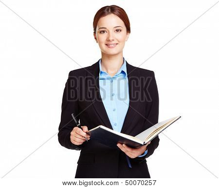 Portrait of young businesswoman or a teacher with open book
