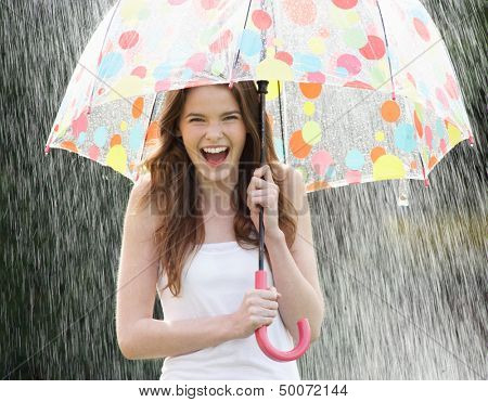 Teenage Girl Sheltering From Rain Beneath Umbrella