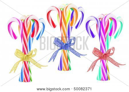 Three Bundles of Colorful Candy Canes On White Background