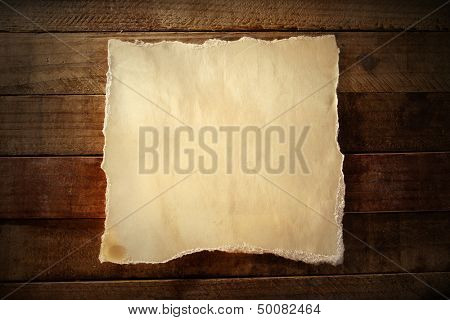 Piece of torn paper on boards