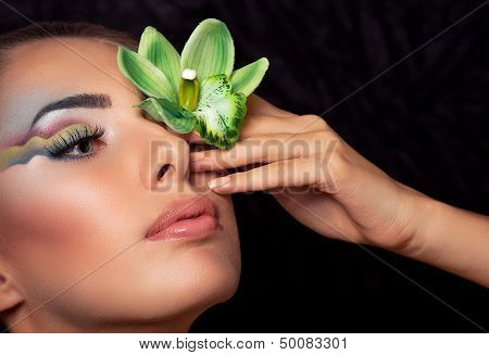 Beautiful young woman with makeup. Fashion portrait