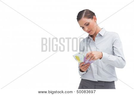 Businesswoman counting her money on white background