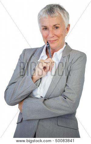 Cheerful businesswoman holding pen on white background