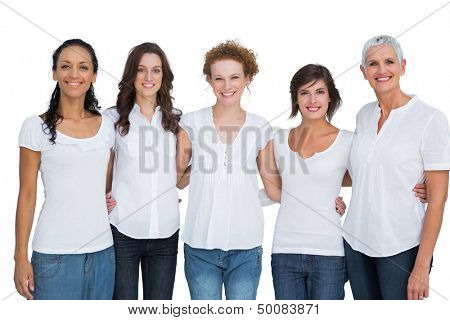 Cheerful pretty women posing with white tops on white background