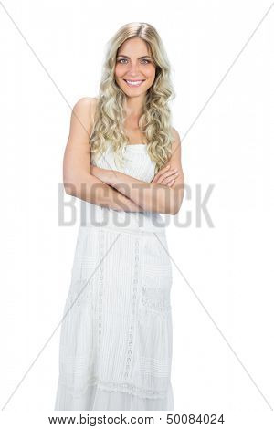 Smiling attractive model in white dress posing on white background