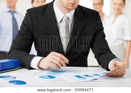 business concept - businessman working with papers